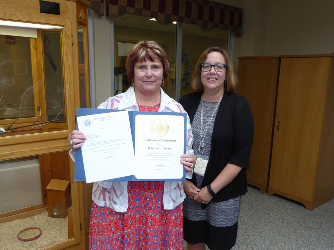 Patricia Staller, left, receives her retirement certificate from Andrea Collins, associate medical center director for Nursing and Patient Care Service at the Oscar G. Johnson VA Medical Center in Iron Mountain. Staller served in the VA as a social worker for 24 years.