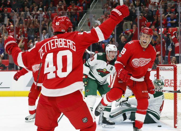 Detroit Red Wings' Anthony Mantha (39) celebrates his goal with Henrik Zetterberg, of Sweden (40) against the Minnesota Wild on Thursday in Detroit. (AP Photo/Paul Sancya)