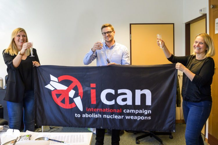 Beatrice Fihn, left, Executive Director of the International Campaign to Abolish Nuclear Weapons (ICAN), Daniel Hogsta, center, coordinator nd Grethe Ostern, right, member of the steering committee, celebrate with champagne at the headquarters of the International Campaign to Abolish Nuclear Weapons (ICAN), in Geneva, Switzerland, on Friday. The International Campaign to Abolish Nuclear Weapons (ICAN) is the winner of this year's Nobel Peace Prize. (AP Photo)