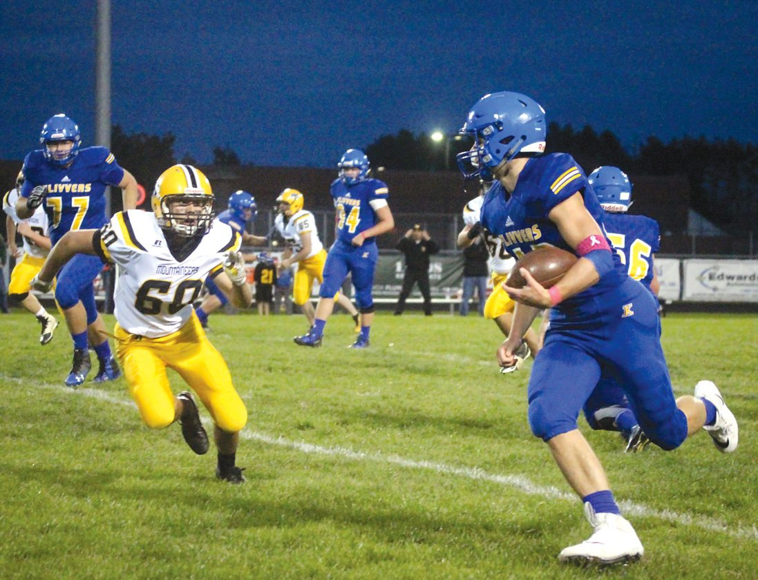Kingsford's Luke Terrian, right, runs as Iron Mountain's Zach Axberg approaches Friday, Oct. 6, 2017, in Kingsford. Terrian ran for two scores in the Flivvers' 42-7 win. (Theresa Proudfit/The Daily News)