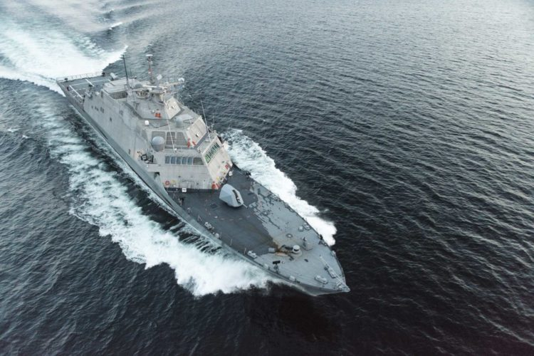 The future littoral combat ship USS Little Rock is shown during a high-speed run in Lake Michigan during acceptance trials. (U.S. Navy Photo)