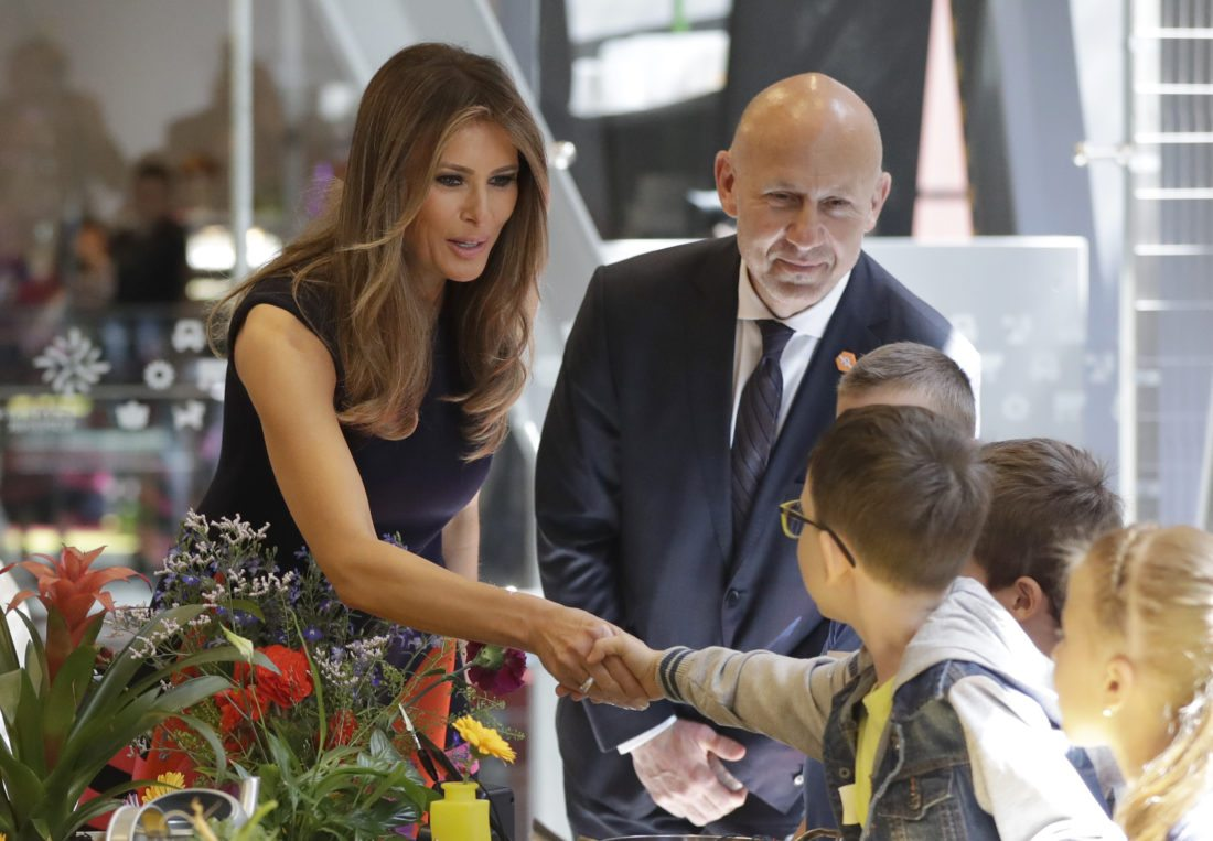 AP Photo FIRST LADY MELANIA TRUMP, left, meets with children July 6 during a visit at the Copernicus Science Center, an interactive science museum geared heavily to young people in Warsaw, Poland.