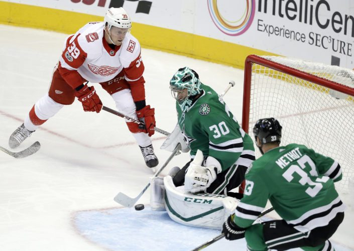 Detroit Red Wings right wing Anthony Mantha (39) pressures as Dallas Stars' Ben Bishop (30) blocks a shot with help from defenseman Marc Methot (33) on Tuesday in Dallas. (AP Photo/Tony Gutierrez)