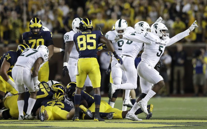 Michigan State recovers a fumble from Michigan running back Ty Isaac on Saturday in Ann Arbor, Mich. (AP Photo/Carlos Osorio)