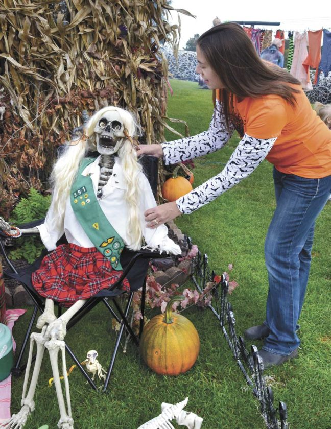 Cathy LeBeau prepares for her fourth annual Haunt on the Hill at 503 Oak St. in Norway. She and her husband, Pat, will offer a sneak preview Friday the 13th and Saturday, weather permitting. The unique outdoor display is completely free to the community and open to all ages. (Terri Castelaz/Daily News photo)