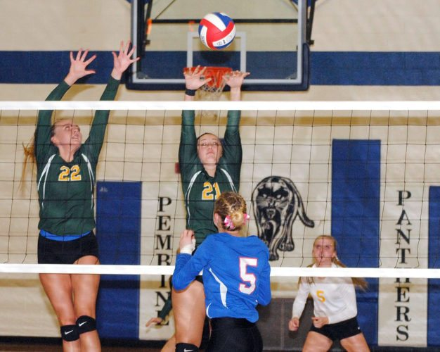 Florence's Bailey Apfel (22) and Sidnie Steber (21) go up for a block on Goodman-Pembine's Mackenna Hirte (5) in Thursday's Northern Lakes Conference volleyball match. Bobcats' Cassie Larson (5) looks on. (Burt Angeli/The Daily News)