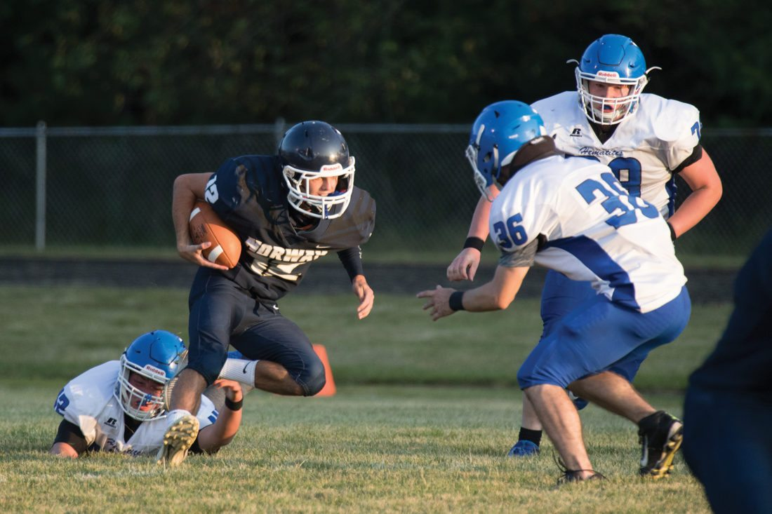 Norway's Trevor Anderson carries the ball against Ishpeming on Friday, Sept. 1, 2017, in Norway, Mich. (Adam Niemi/Iron Mountain Daily News)