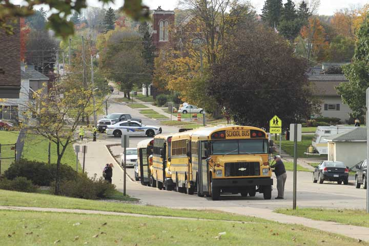 NORWAY POLICE PATROL the area around Norway-Vulcan Area Schools as school buses line up outside the Norway Fine Arts Center on Fourth Avenue between Chestnut and Section streets in Norway. (Theresa Proudfit/Daily News photo)