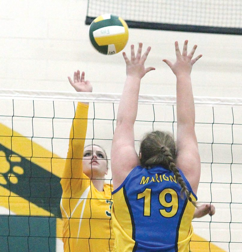 Florence's Shayla McLain (3) hits the ball at Marion's Kendra Barrow (11) in Tuesday's WIAA Division 4 volleyball regional opener. (Theresa Proudfit/The Daily News)