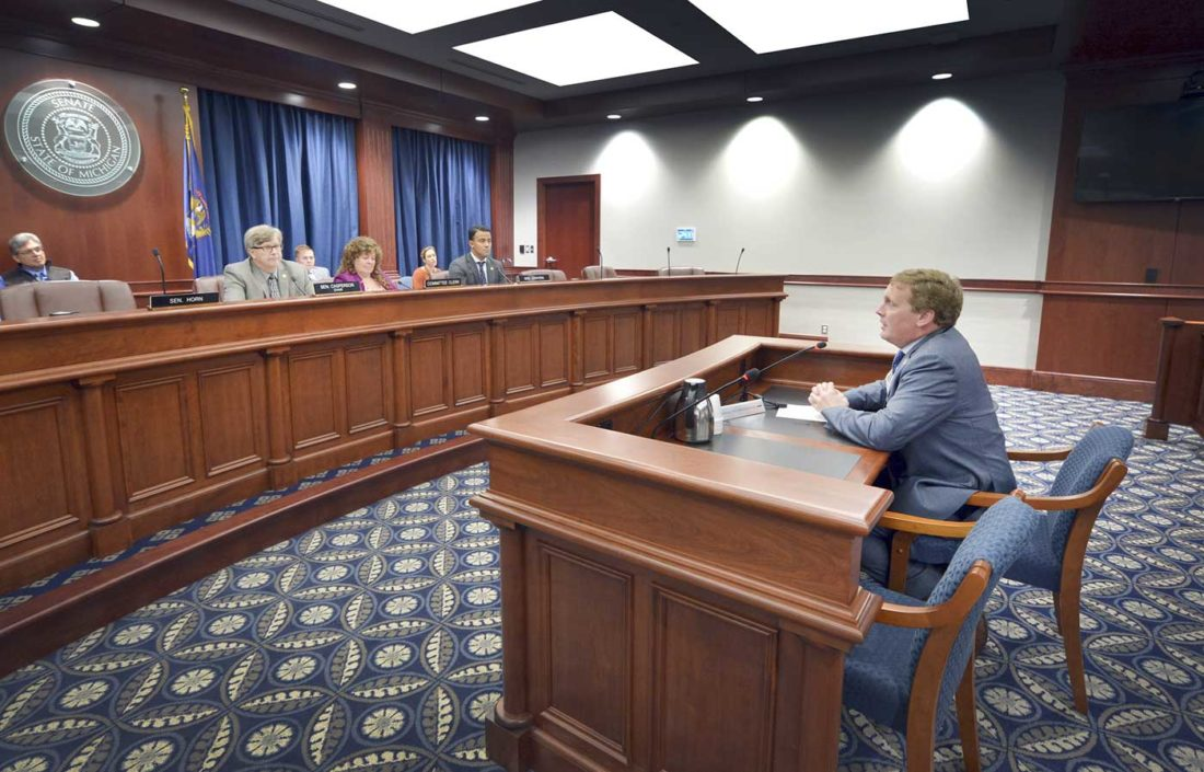 """SENATE TRANSPORTATION COMMITTEE Chairman Tom Casperson, R-Escanaba, listens to former state Rep. Ed McBroom outline his support of Casperson's legislation to designate part of U.S. 8 as the """"Medio J. Bacco Memorial Highway."""""""