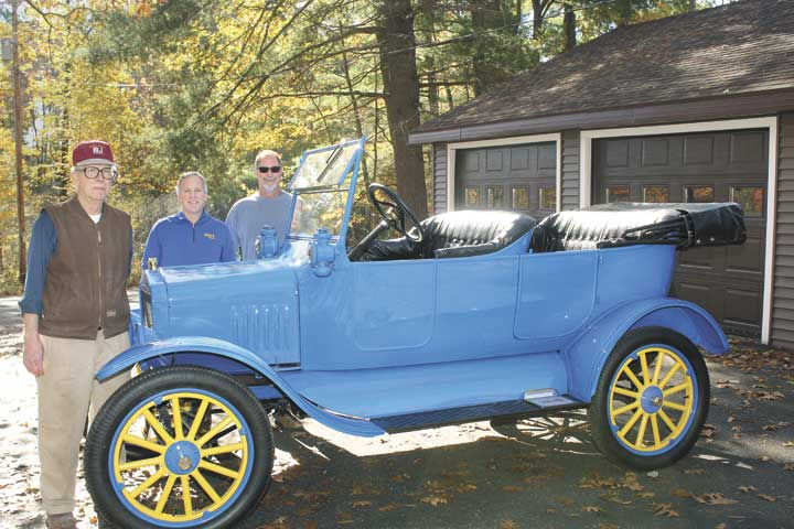 "FROM LEFT, CLYDE UNGER, Al Unger and Bill Edens stand with the ""Kingsford Flivver,"" a 1923 Ford Model T car donated to the Breitung Township Schools, now refurbished for display as the district's team mascot at Kingsford Middle School. (Theresa Proudfit/Daily News photo)"