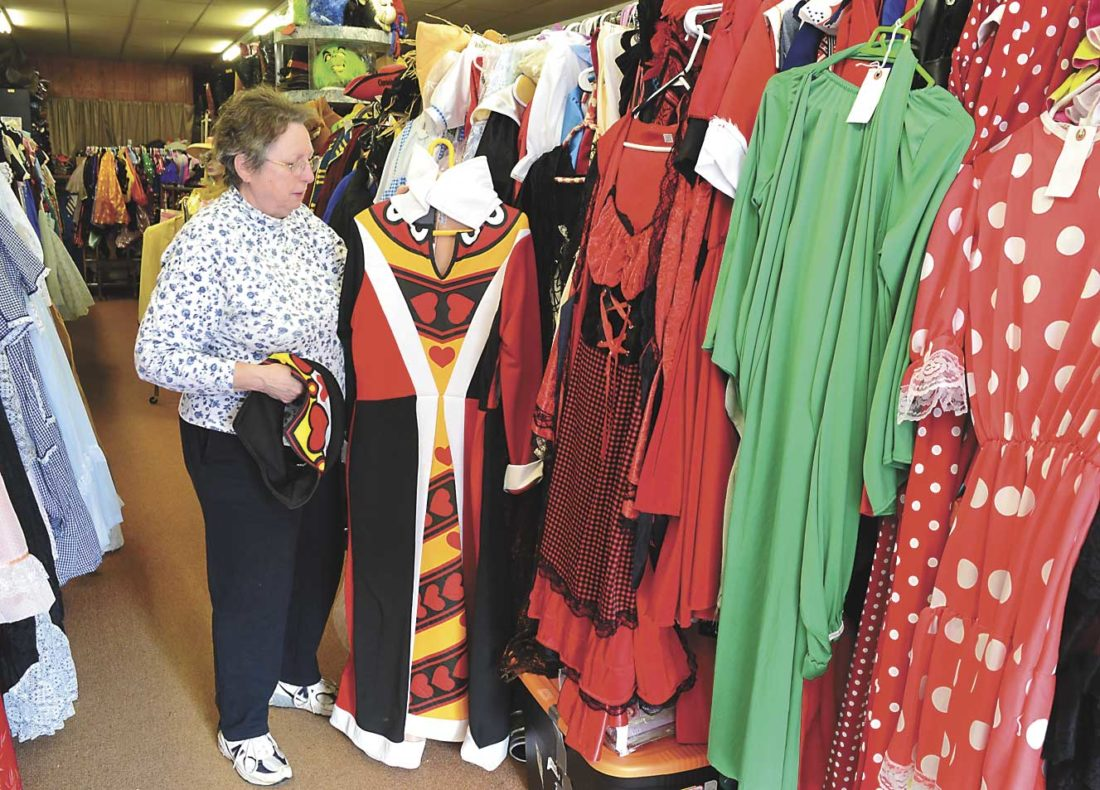 THE COSTUME CLOSET volunteer manager Gloria Frederickson displays the Queen of Hearts character, one of thousands of costumes available for rent this Halloween season at the shop in Crystal Falls. (Terri Castelaz/Daily News photo)