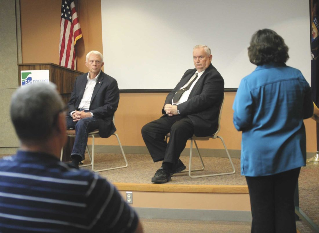 U.S. REP. JACK BERGMAN, left, listens to Susanne Gedvick talk about her experiences with the Veterans Choice program. To Bergman's right is Joe Testolin of Americans for Constitutional Enforcement, which organized the event. (Theresa Proudfit/Daily News photo)