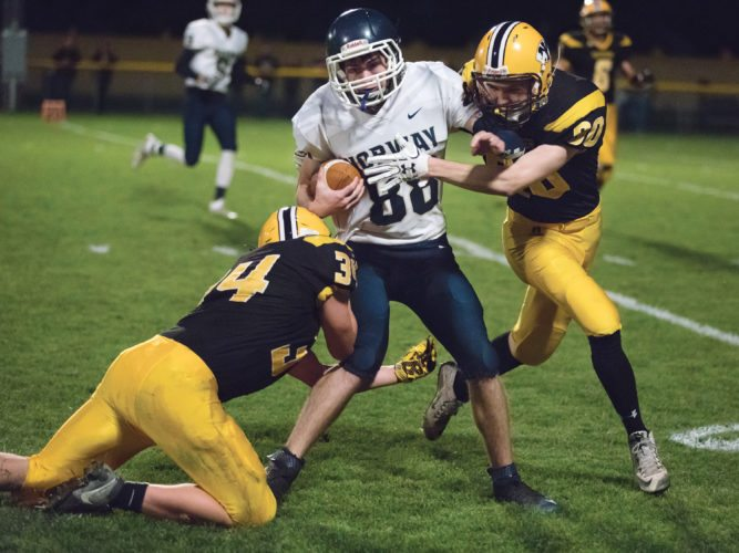 Norway's Mitchell LeGrave (88) is tackled by Iron Mountain's Sawyer Hicks (34) and Teagan Erickson (80) on Friday in Iron Mountain. (Adam Niemi/Iron Mountain Daily News)