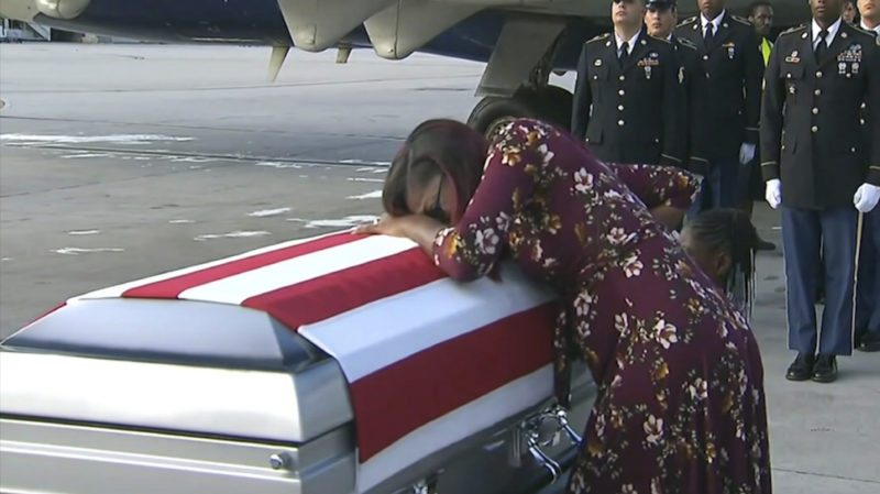 In this Tuesday, Oct. 17,  frame from video, Myeshia Johnson cries over the casket of her husband, Sgt. La David Johnson, who was killed in an ambush in Niger, upon his body's arrival in Miami. (AP Photo)