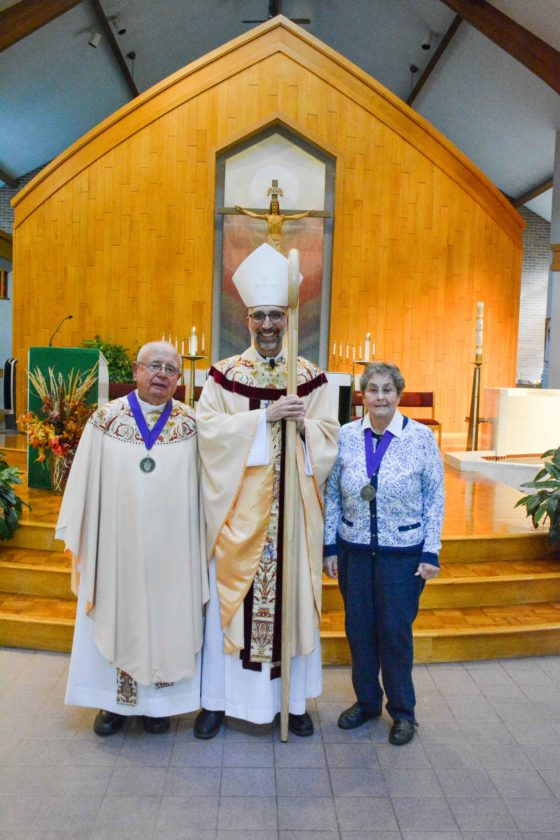 2017 Catholic Service Award honorees the Rev. Joseph Gouin of Kingsford and Judy Boyle of Marquette are joined by Bishop John Doerfler of the Diocese of Marquette at St. Michael Parish in Marquette before an Oct. 7 banquet honoring them and the Bishop's Ambassadors.