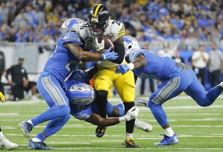 Pittsburgh Steelers running back Le'Veon Bell (26) is tackled by Detroit Lions cornerback Quandre Diggs, left, on Sunday in Detroit. (AP Photo/Rick Osentoski)