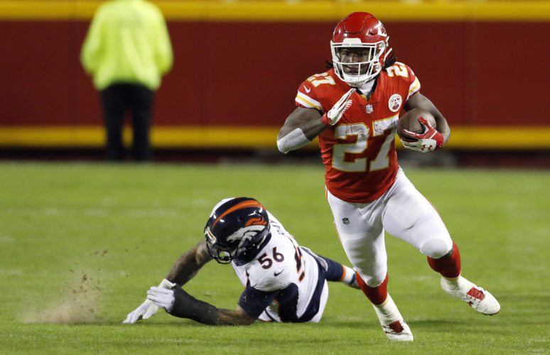 Kansas City Chiefs running back Kareem Hunt (27) runs past a tackle attempt by Denver Broncos linebacker Shane Ray (56) during the first half on Monday in Kansas City, Mo. (AP Photo/Colin E. Braley)