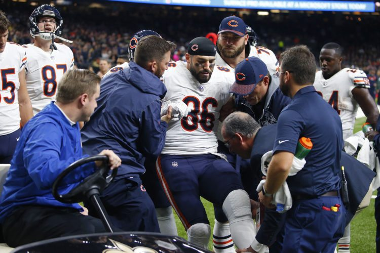 Chicago Bears tight end Zach Miller (86) is placed on a cart after injuring his leg in the second half against the New Orleans Saints in New Orleans on Sunday. Miller hurt his leg on an apparent touchdown reception that was overturned on review. (AP Photo/Butch Dill)