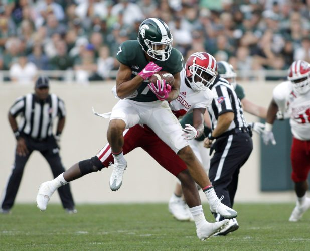 Michigan State receiver Cody White, left, catches a pass against Indiana's Andre Brown Jr. on Oct. 21 in East Lansing, Mich. (AP Photo/Al Goldis)