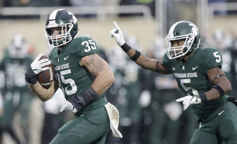 Michigan State linebacker Joe Bachie (35) carries the ball during the second half game against Penn State on Saturday in East Lansing, Mich. (AP Photo/Carlos Osorio)