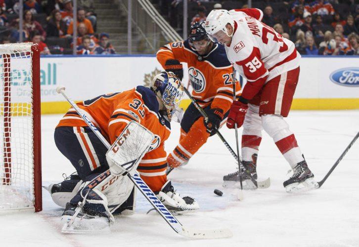 Detroit Red Wings Anthony Mantha (39) scores a goal on Edmonton Oilers goalie Cam Talbot (33) as Darnell Nurse (25) defends on Sunday in Edmonton, Alberta. (Jason Franson/The Canadian Press via AP)