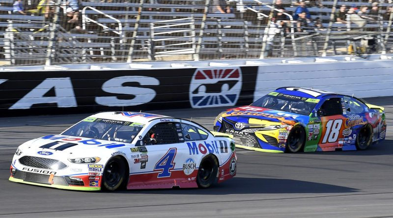 Kevin Harvick (4) races against Kyle Busch (18) during an NASCAR Cup Series auto race at Texas Motor Speedway in Fort Worth, Texas on Sunday. (AP Photo/Larry Papke)