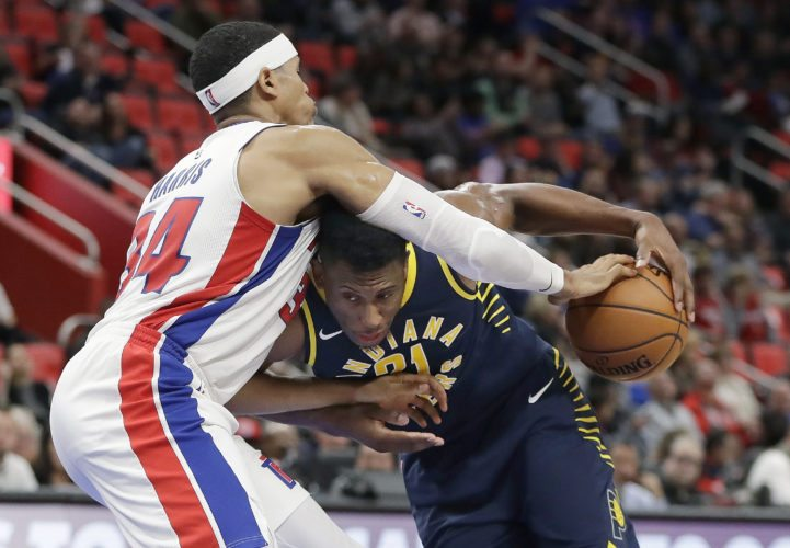 Indiana Pacers forward Thaddeus Young (21) runs in to Detroit Pistons forward Tobias Harris (34) on Wednesday in Detroit. (AP Photo/Carlos Osorio)