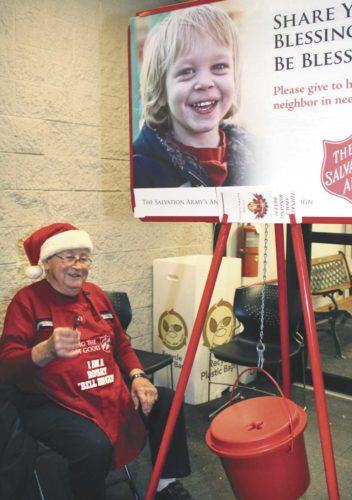 WALTER JENSEN RINGS the bell for the Salvation Army at Shopko in Kingsford in 2016. (Theresa Proudfit/Daily News photo)