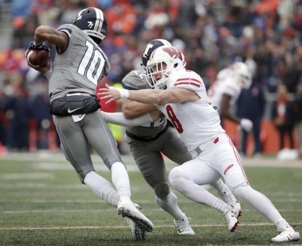 Wisconsin safety Joe Ferguson (8) pressures Illinois quarterback Cam Thomas (10) Oct. 28 at Memorial Stadium in Champaign, Ill. Ferguson is making a name for himself at No. 6 Wisconsin. Athletic director Barry Alvarez's grandson has become an important contributor off the bench and turnover specialist on the Badgers' tough defense. (M.P. King/Wisconsin State Journal via AP)