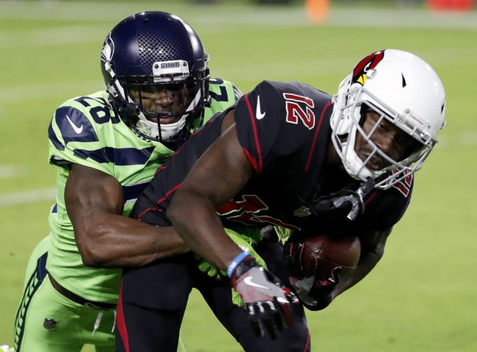 Arizona Cardinals wide receiver John Brown (12) is tackled by Seattle Seahawks cornerback Justin Coleman (28) on Thursday in Glendale, Ariz. (AP Photo/Rick Scuteri)