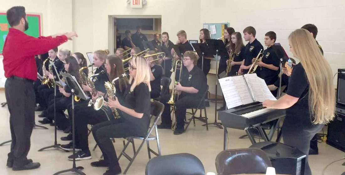 The Iron Mountain Jazz Band, under the direction of Craig Recla, performs at the Golden K meeting.