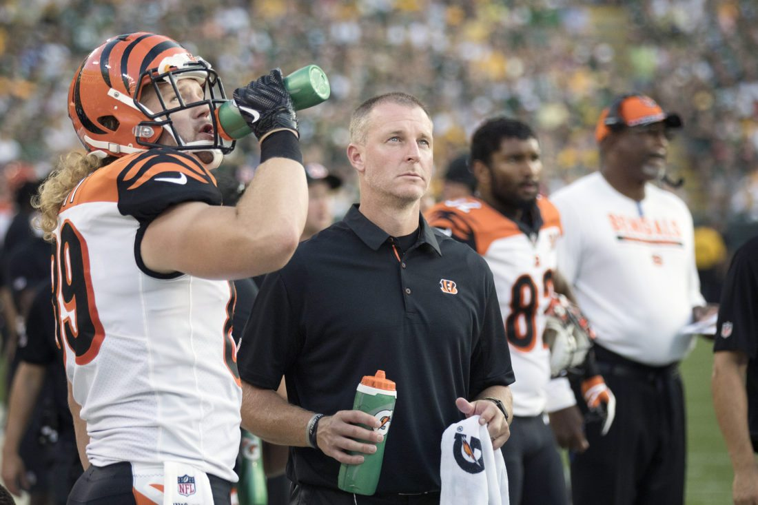 Jon Jungwirth, right, watches a replay alongside Cincinnati Bengals Ryan Hewitt during a game against the Green Bay Packers on Sunday, Sept. 24, 2017, in Green Bay, Wis. Jungwirth, an athletic trainer from Iron Mountain, Mich., worked as an athletic trainer on the BengalsÕ sideline. (Adam Niemi/Iron Mountain Daily News)