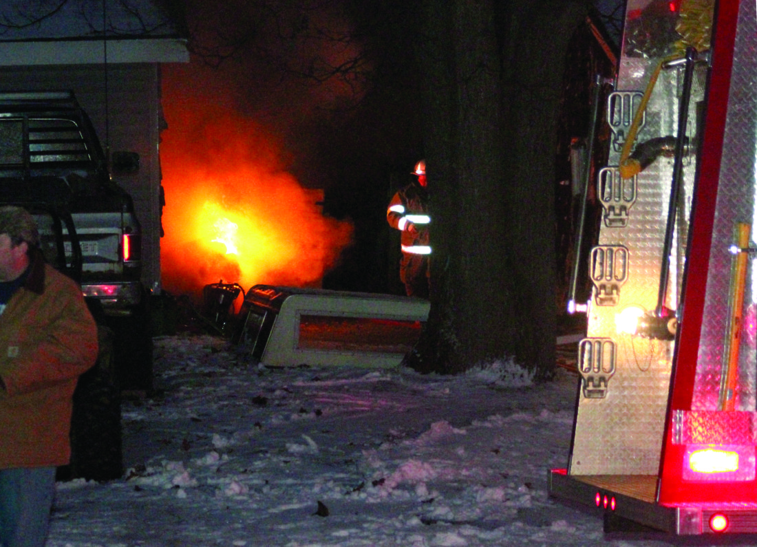 Breitung Township firefighters responded to a fire that damaged two garages on Lake Avenue in Quinnesec on Monday.