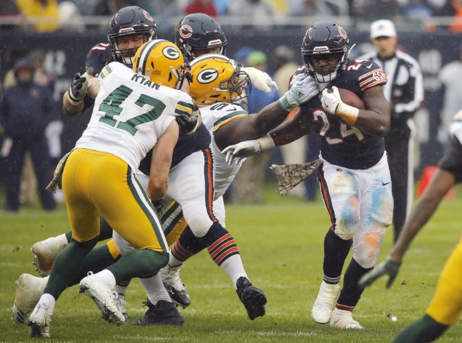 Green Bay Packers nose tackle Kenny Clark (97) grabs Chicago Bears running back Jordan Howard (24) during the first half of an NFL football game, Sunday, Nov. 12, 2017, in Chicago. (AP Photo/Charles Rex Arbogast)