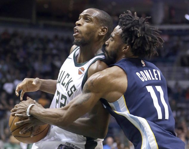 Memphis Grizzlies' Mike Conley (11) strips the ball from Milwaukee Bucks' Khris Middleton during the second half of an NBA basketball game Monday, Nov. 13, 2017, in Milwaukee. The Bucks won 110-103. (AP Photo/Aaron Gash)