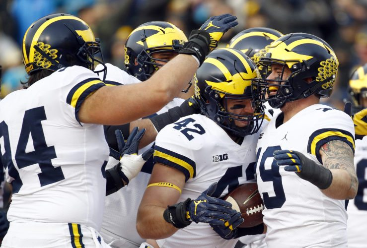 Michigan fullback Henry Poggi, right, celebrates his touchdown with teammates in the first half of an NCAA college football game against Maryland in College Park, Md., Saturday, Nov. 11, 2017. (AP Photo/Patrick Semansky)