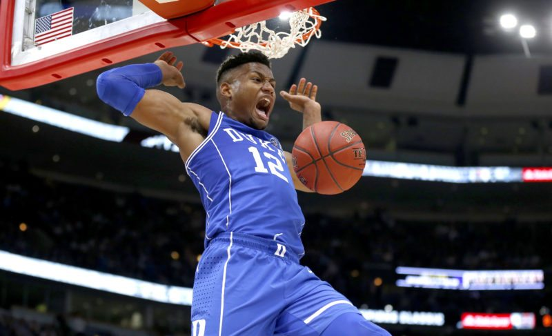 Duke forward Javin DeLaurier reacts after dunking the ball during the closing seconds of an NCAA college basketball game against Michigan State on Tuesday, Nov. 14, 2017, in Chicago. Duke won 88-81. (AP Photo/Charles Rex Arbogast)