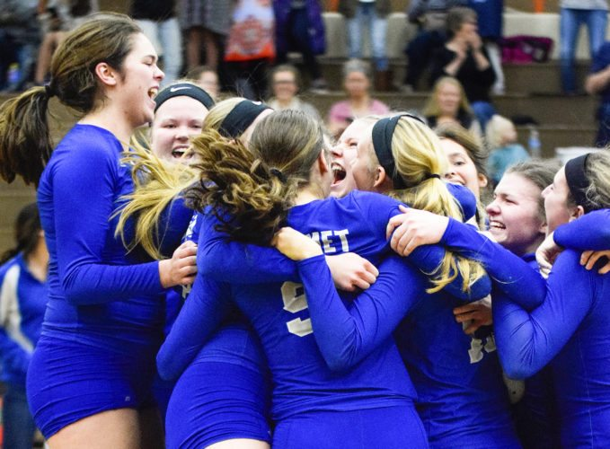 Calumet celebrates after sweeping Houghton Lake on Tuesday in Munising in a Class C state quarterfinal. (Bryce Derouin/The Daily Mining Gazette)