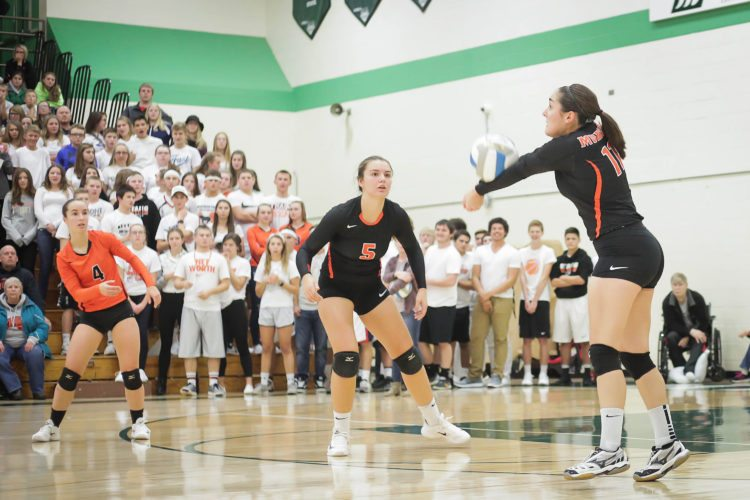 Keira Stampfly, right, catches the ball squarely for a bump in Munising's Class D quarterfinal volleyball match against Rudyard in Manistique on Tuesday, Nov. 14, 2017. Teammates Kianne Wendt, center, and Marissa Ackerman look on. (Isiah Otten/Sault News)