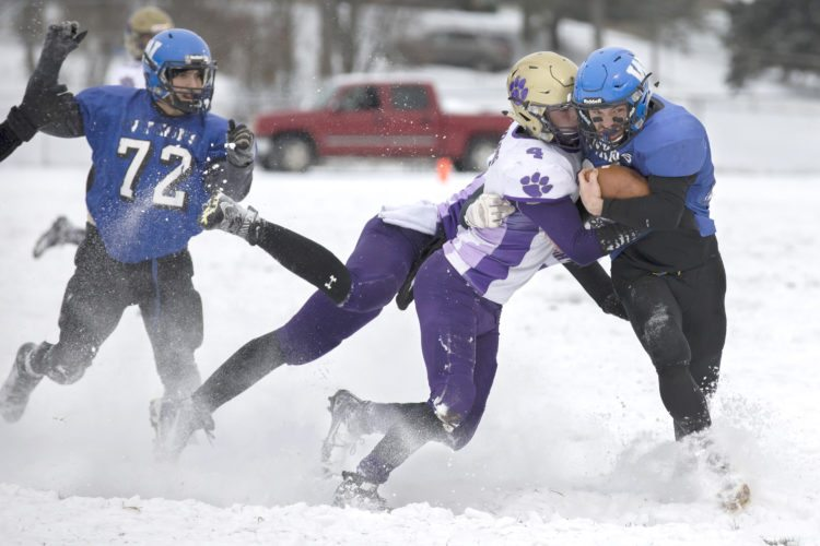 West Iron County running back Austin Persson, right, runs with the ball against Frankfort during a Division 8 regional final on Saturday, Nov. 11, 2017, in Iron River, Mich. (Adam Niemi/Iron Mountain Daily News)