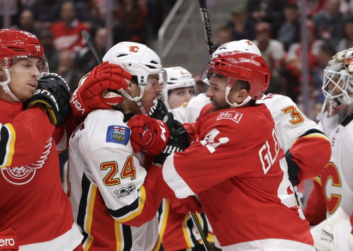 Calgary Flames defenseman Travis Hamonic (24) and Detroit Red Wings right wing Luke Glendening (41) are separated during the second period of an NHL hockey game, Wednesday, Nov. 15, 2017, in Detroit. (AP Photo/Carlos Osorio)