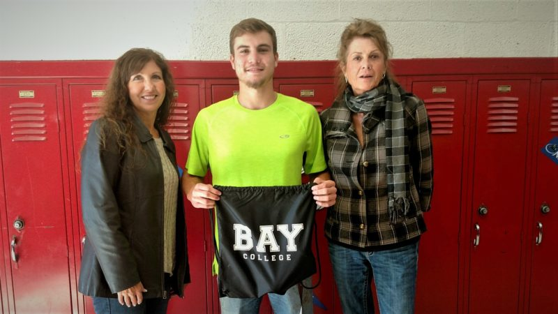 Shaun Gogolewski, center, a student at North Central High School, was the winner of a drawing held as part of  Career Day @ Bay. He is pictured with Bay College Computer Information Systems instructors Joyce King, left, and Cheryl Miller.