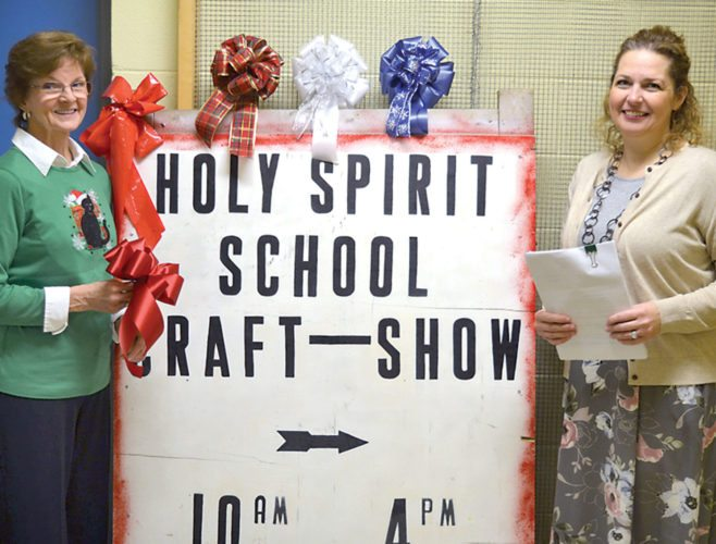 Rose Gianunzio, event coordinator, left, and Holy Spirit Principal Melissa Menghini prepare for this weekend's craft show.