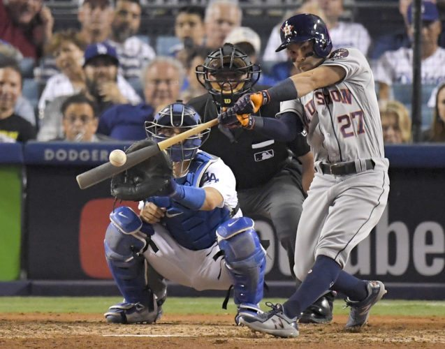 Houston Astros' Jose Altuve hits a home run against the Los Angeles Dodgers during the 10th inning of Game 2 of baseball's World Series in Los Angeles.  Altuve and Miami Marlins' Giancarlo Stanton won the AL and NL MVP awards, respectively. (AP Photo/Mark J. Terrill, File)