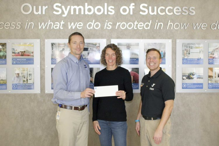 FROM LEFT, SYSTEMS Control President Brad Lebouef presents a check to Northern Lights YMCA board member Stephanie Brule and Dickinson Center Director Jonathan Ringel. The company has pledged $150,000 to the YMCA's planned renovations.