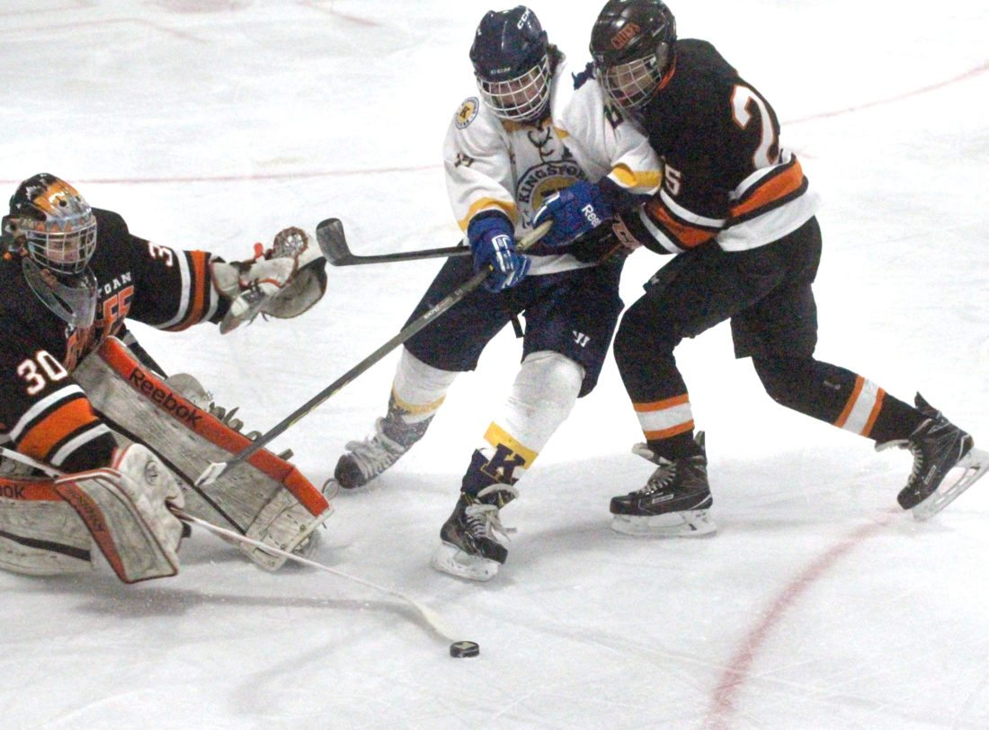 Kingsford's TJ Burke (13) battles for the puck with Cheboygan goalie Tyler Kiper (30) and Caleb Williams (25) in Saturday's game at Mountain View Ice Arena. (Theresa Proudfit/The Daily News)