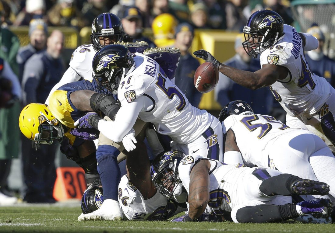Green Bay Packers' Devante Mays fumbles the ball against the Baltimore Ravens Sunday in Green Bay, Wis. The Ravens recovered the ball. (AP Photo/Jeffrey Phelps)