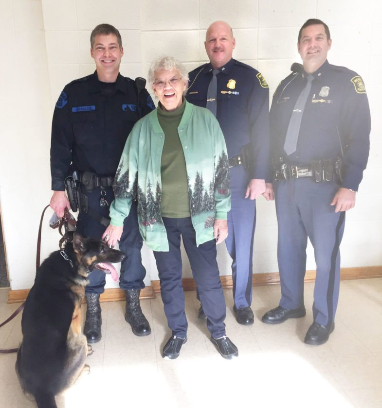 Pictured are Trooper Ryan Rossler and Nikko, Joan Jouppi, First Lt. Paul Campbell and Trooper Geno Basanese.