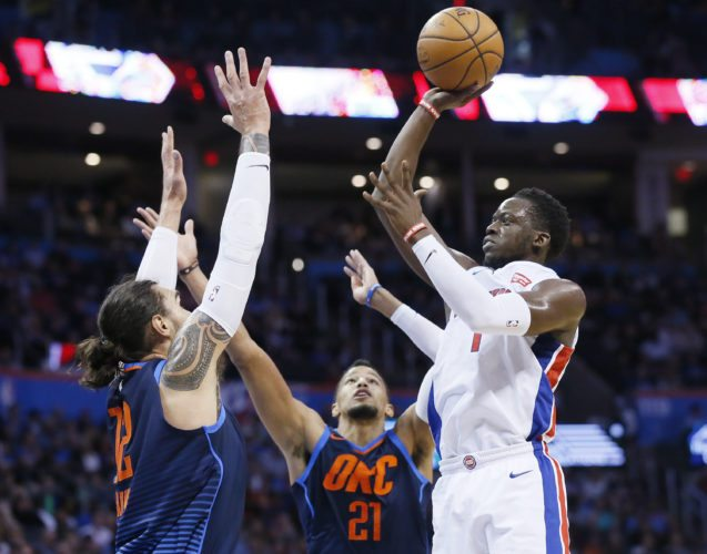 Detroit Pistons guard Reggie Jackson, right, shoots in front of Oklahoma City Thunder center Steven Adams, left, and guard Andre Roberson (21) on Friday in Oklahoma City. (AP Photo/Sue Ogrocki)